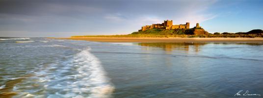 Bamburgh Castle Beach, UK by Ken Duncan